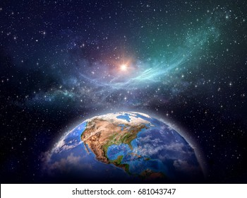 Planet Earth focused on North America, star cluster and nebula in outer space, bright light shining far behind - Elements of this image furnished by NASA