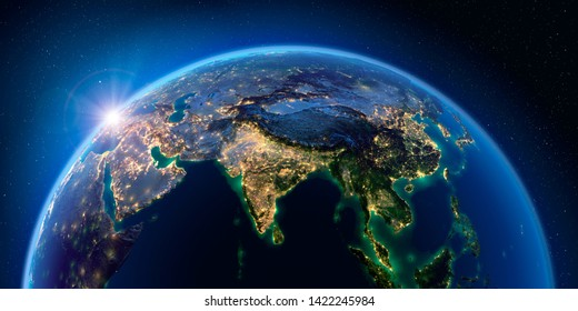 Planet Earth at night with the rising sun with the light of cities illuminating a detailed exaggerated relief. India. South-east Asia. 3D rendering. Elements of this image furnished by NASA