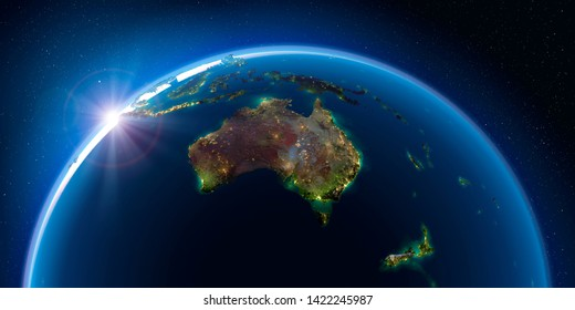 Planet Earth at night with the rising sun with the light of cities illuminating a detailed exaggerated relief. Australia and New Zealand. 3D rendering. Elements of this image furnished by NASA