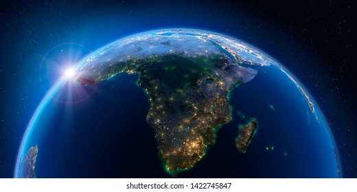 Planet Earth at night with the rising sun with the light of cities illuminating a detailed exaggerated relief. South Africa and Madagascar. 3D rendering. Elements of this image furnished by NASA