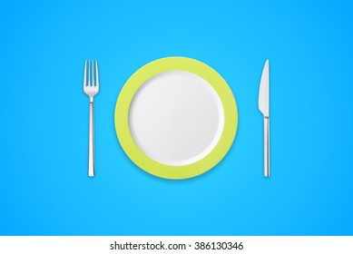 Plate with fork and knife on blue background