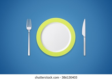 Plate with fork and knife on navy background