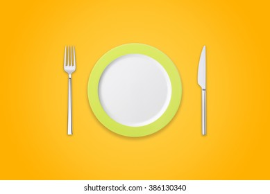 Plate with fork and knife on orange background