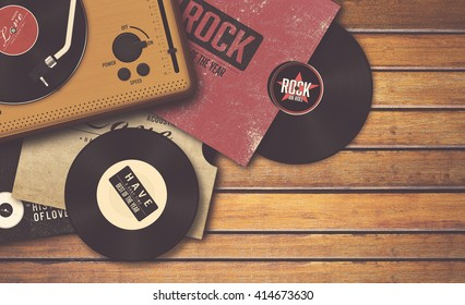 player and vinyl record on wooden background