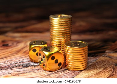 Playing dice with gold coins on wooden table. 3D illustration.