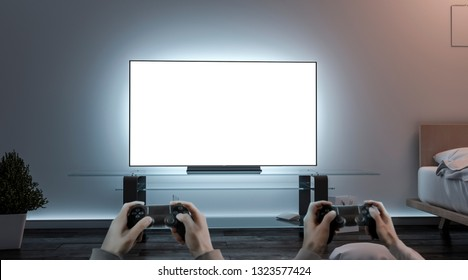 Playing videogame with joystick near blank white tv screen mockup, 3d rendering. Empty lcd monitor and two person holding controller mock up, front view. Play gaming on widescreen in room template.