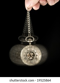 pocket watch swung as if to hypnotize