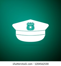 Police cap with cockade icon isolated on green background. Police hat sign. Flat design
