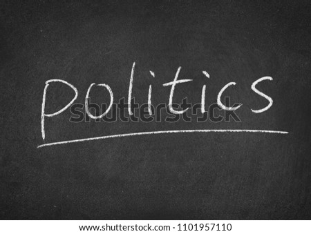 politics concept word on a blackboard background