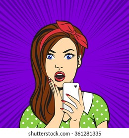Pop art surprised woman face with open mouth holding a phone in her hands