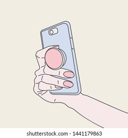 Pop socket phone holder in woman hand. Ring holder for phone Pop socket. Smartphone accessory holder. Suction Cup ring for phone