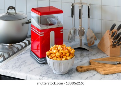Popcorn maker on the kitchen table. 3D rendering