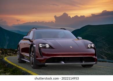 Porsche Taycan Cross Turismo on a beautiful mountain .3D illustration.