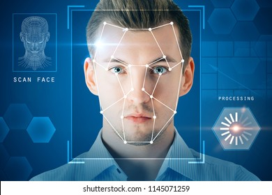 Portrait of attractive young businessman with facial recognition system. Authentication and privacy concept