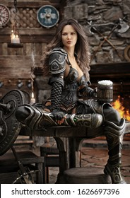 Portrait of a fantasy warrior female relaxing in a medieval tavern with ale after a long journey. 3d rendering