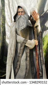 Portrait of a hooded grey cloaked wizard holding his magical staff in an enchanted forest . 3d rendering