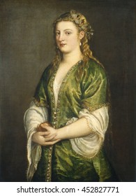 Portrait of a Lady, by Titian, 1555, Italian Venetian painting, oil on canvas. The unnamed young Venetian woman wears a white shift with gold braid edging, under an overdress adorned with pearls and