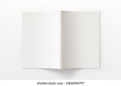 Portrait Magazine with blank soft cover isolated on white. 3d illustration for your presentation.