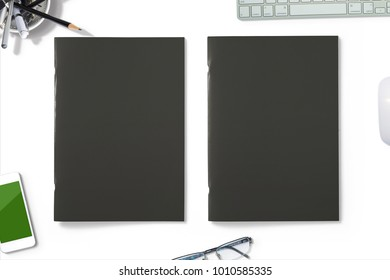 Portrait Magazines with black soft covers isolated on white. Hero header 3d Illustration with workplace objects for your presentation.