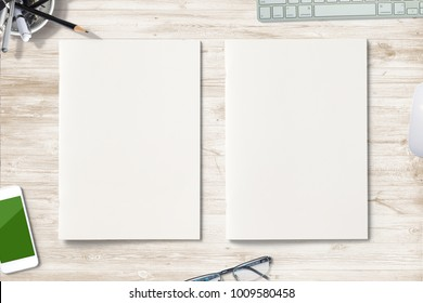 Portrait Magazines with blank soft covers on wooden desk. Hero header 3d Illustration with workplace objects for your presentation.