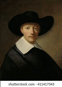 Portrait of a Man, known as Gozen Centen, by Govert Flinck, c. 1639 -40, oil on panel. Gozen Centen lived from 1411 to 1677. He wears a wide brim hat and simple flat linen collar