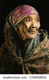 a portrait of an old lady from the tengger tribe. this picture was taken at the Bromo Tengger Semeru National Park - East Java - Indonesia on 28 September 2018