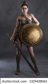 Portrait of a sexy amazon female posed with a sword,shield and a studio background. 3d rendering