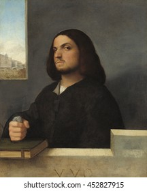 Portrait of a Venetian Gentleman, by Giovanni Cariani, 1485-90, Italian Renaissance painting, oil on canvas. The sitter's facial expression, his closed fist, and glancing sidelong glance at the viewe