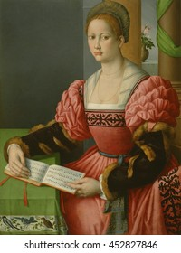 Portrait of a Woman with a Book of Music, by Bacchiacca, 1540, Italian Renaissance painting, oil on canvas. Young woman in an elegant, dress with embroidered panels and fur lined sleeves. She may hav