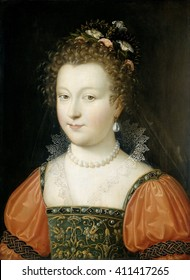 Portrait of a Woman, by Anonymous, 1550-74, Netherlandish painting, oil on panel. Young woman with flowers in her hair, pearl jewelry, and embroidered corset bodice