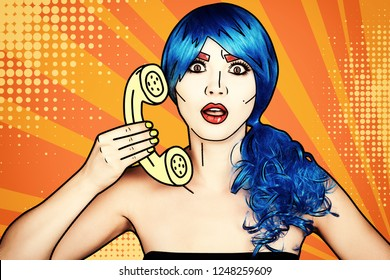 Portrait of young woman in comic pop art make-up style. Female in blue wig on yellow - orange cartoon background calls by phone.