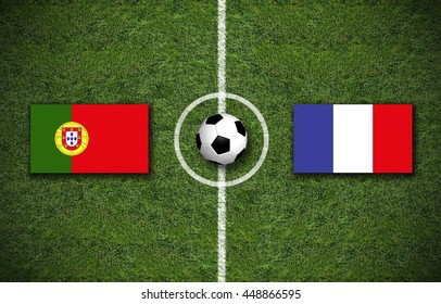 Portugal vs. France flags on a green soccer field