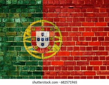 Portuguese flag on an old brick wall background