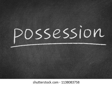 possession concept word on a blackboard background