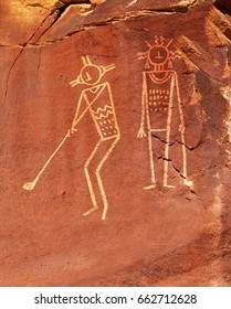 Poster or ad concept using primitive line drawings on sandstone of two people playing golf.