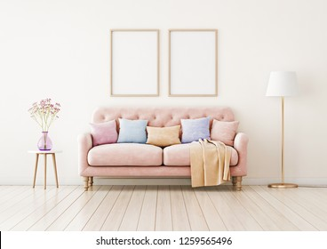 Poster mockup with two vertical frames on empty wall in living room interior with pink sofa and multi-colored pastel pillows. 3D rendering.
