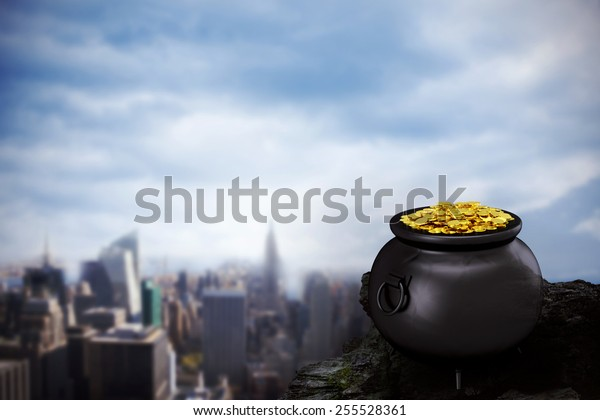 pot of gold against large rock overlooking big city