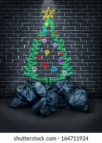 Poverty during the holidays as a concept for social financial challenges of poor families or the homeless as spray painted graffiti of a christmas tree on a brick wall with garbage bags as gifts.