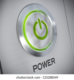 power button on a brushed aluminum panel with a green light and the symbol of energy start, blur effect
