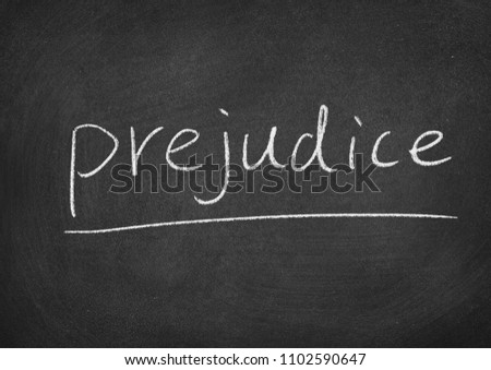 prejudice concept word on a blackboard background