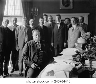President William H. Taft at his desk in the Oval Office he had built centered in the south side of the West Wing of the White House. The room had Georgian Revival details and green walls. Ca. 1910.