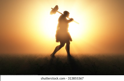 Primitive man silhouette against the sun.