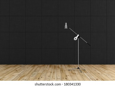 Professional microphone in a recording studio with black acoustic panel and wooden floor - rendering