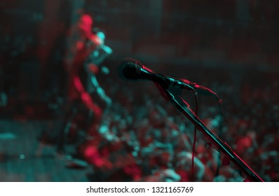 Professional vocal microphone on stand at rap concert.Illustration of vocal mic edited with 3d stereo effect.High quality audio equipment on stage in music hall