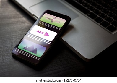 Programmatic Advertising - online native digital targeting ads marketing strategy. Advertising media banner block when viewing a site on a mobile phone screen.