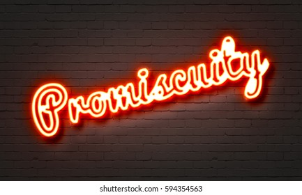 Promiscuity neon sign on brick wall background