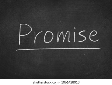promise concept word on a blackboard background