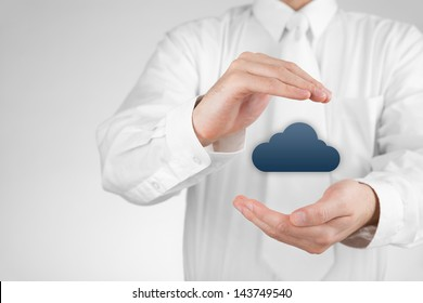 Protect cloud computing data concept. Security and safety of cloud computing. Protecting gesture of businessman and cloud icon.