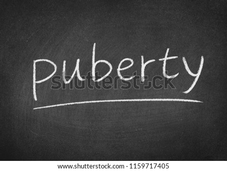 puberty concept word on a blackboard background