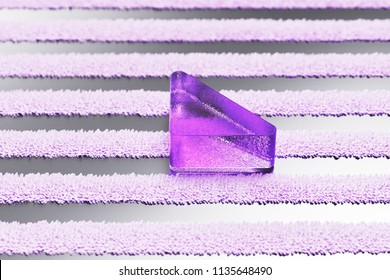 Purple Caret Down Icon on the Gray Striped Pattern. 3D Illustration of Purple Arrow, Caret, Down, Download Icon Set With Stripes Gray Background.